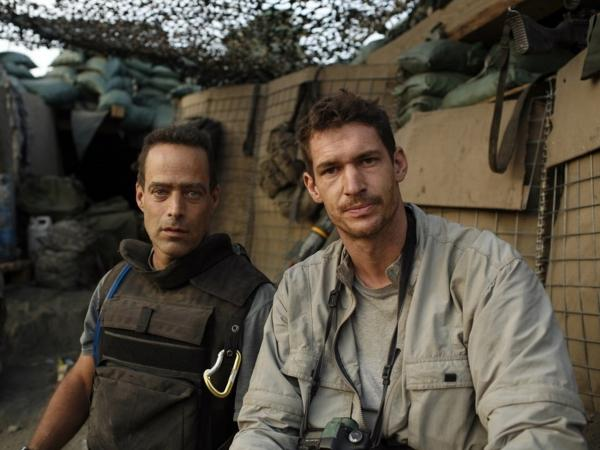 Award-winning photojournalist Tim Hetherington (right) known for his work in war zones, died Wednesday in the Libyan city of Misrata when he was hit by a mortar round. He is pictured here with Sebastian Junger, his co-director of the film <i>Restrepo</i>, which was nominated for the best-documentary Oscar this year.
