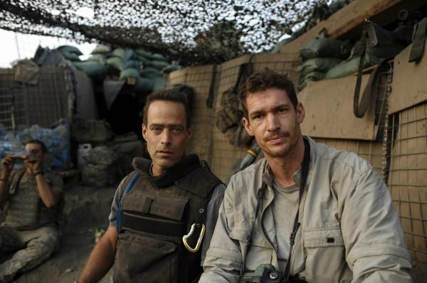 Tim Hetherington (right) co-directed the documentary <em>Restrepo</em> with Sebastian Junger. Hetherington was killed Wednesday covering the battle between rebel forces and the Gadhafi regime in Libya.
