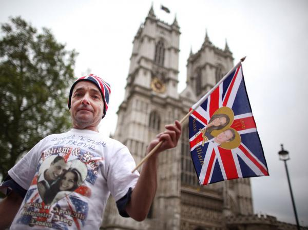 Royal fan John Loughrey camps out on the streets outside Westminster Abbey Tuesday in anticipation of England's royal wedding.