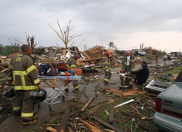 Birmingham Rescue attends to a man who was injured after a tornado hit Pratt City, Ala., on Wednesday.