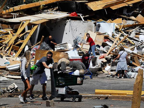 People reclaim some of their belongings in the Alberta City neighborhood   Thursday April 28, 2011, after a tornado  struck Tuscaloosa, Ala. the day before.