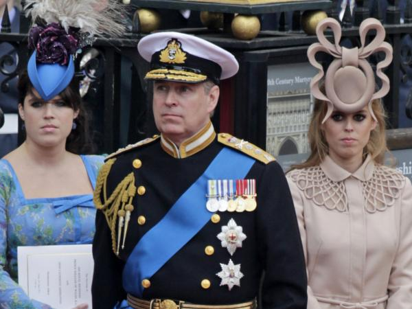 Britain's Prince Andrew (center) and his daughters, Britain's Princess Eugenie (left) and Princess Beatrice leave Westminster Abbey. (Gero Breloer/AP)