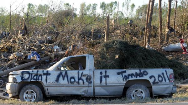 A damaged truck in a tornado-ravaged area near Rainsville, Ala.