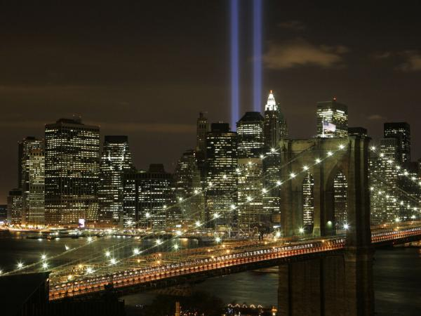 The Tribute in Light illuminates the sky over the Brooklyn Bridge and Lower Manhattan, Sept. 11, 2008.