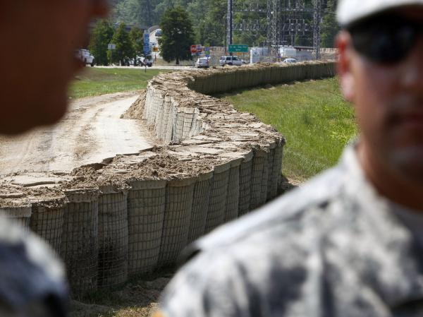 Louisiana National Guardsmen were deployed in Morgan City to top off local levees with sand-filled baskets in advance of  possible flooding if the Morganza Spillway north of Baton Rouge is  opened.