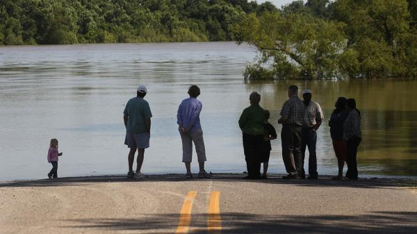People in Krotz Springs, La., gazed out at the flooded Atchafalaya River on Sunday as officials ordered a mandatory evacuation for some parts of town.