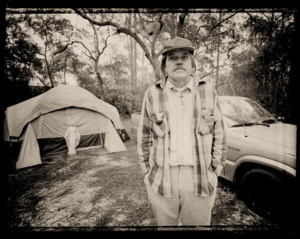 """We camped in Ochlockonee River State Park in Florida and every day I'd walk by this tent and there was a Madonna, an old car and nobody around. It fascinated me. After a couple of days, Randy crawled out of the tent. He was on a pilgrimage to a statue that was bleeding in Mississippi. He ran out of money waiting for his miracle. I gave him $20 for gas and he went down the road to see the statue."""