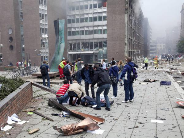 Injured people lay on the ground at the site of an explosion near the government buildings in Norway's capital Oslo earlier today (July 22, 2011).