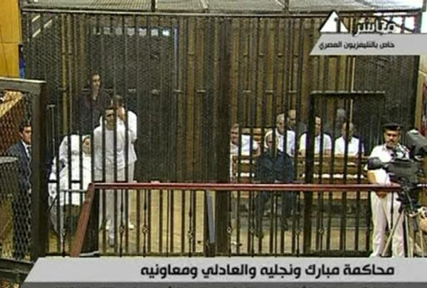 This video image taken from Egyptian state television shows former President  Hosni Mubarak, 83, lying on a hospital bed inside a cage of mesh and iron bars in a  Cairo courtroom as his trial began Wednesday.