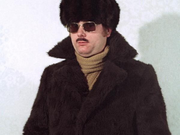 Staged photos re-create Stasi agents dressed in various disguises, ranging from a Russian mafioso to the casual middle-aged man to a tourist with cameras.