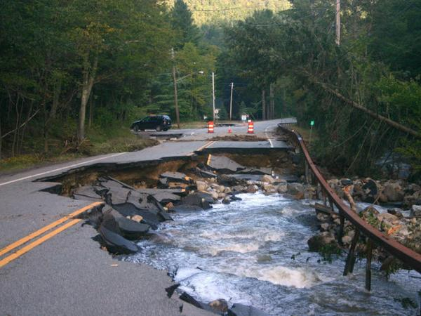 Roaring Brook flows onto Route 73 in Keene, N.Y., on Tuesday.