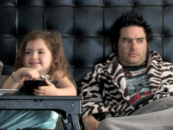 "The film offers glimpses into the lives of punk idols from skateboarder Tony Hawk to ""Fat Mike"" — Michael John Burkett of the band NOFX, shown with his daughter, Darla."