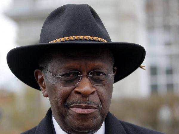 Republican presidential candidate Herman Cain, seen here in Concord, N.H., earlier this month, is reassessing his campaign after denying allegations this week that he engaged in a long-term affair.