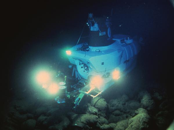 Beneath 8,200 feet of water, the Alvin submarine scopes out the Pacific's seafloor in the 1970s. The geologists aboard weren't searching for life — they were on the hunt for hot spots and undersea thermal vents.