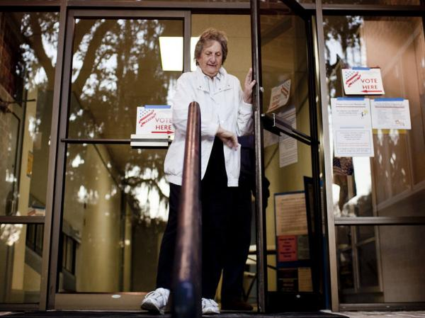 Marjorie Reddick, of Micanopy, Fla., leaves a polling location after voting in the state's Republican party primary on Tuesday.