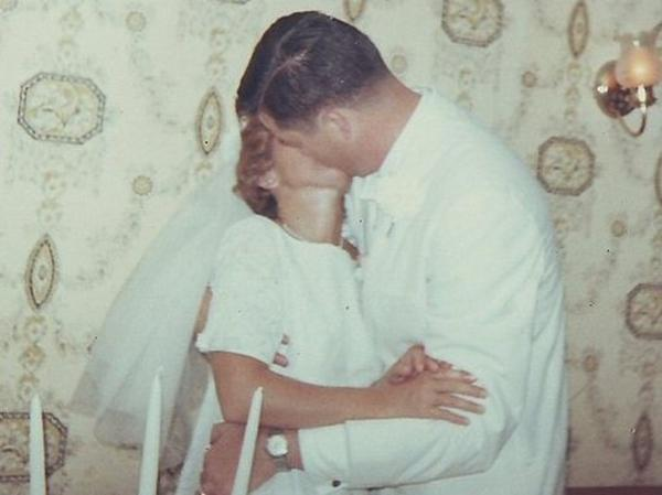 Peggy and John Fugelsang kiss on their wedding day.