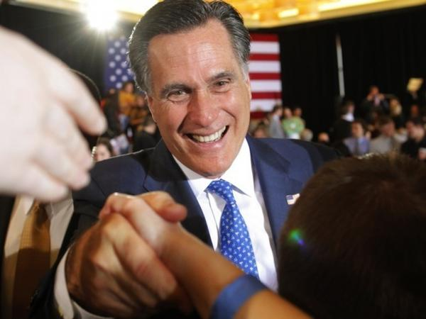 Republican presidential candidate Mitt Romney shakes hands with supporters at his Super Tuesday rally in Boston.