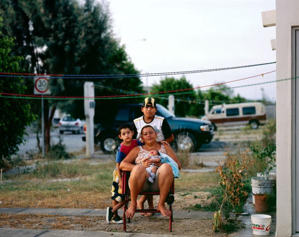 Cartagena also uses portraits in his series <em>Suburbia Mexicana</em> to give a more human lay of the land.