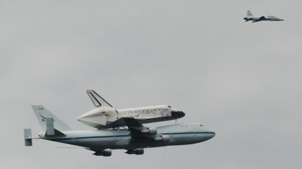 Space Shuttle Discovery, riding atop a jumbo jet, as it passed over Chevy Chase, Md., this morning.