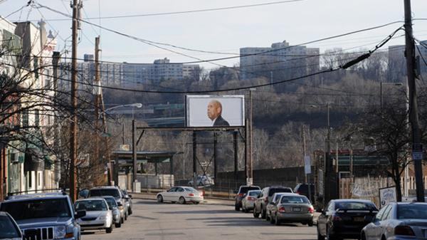 A distant billboard with Strauss' photo of Nathaniel J. Jordan
