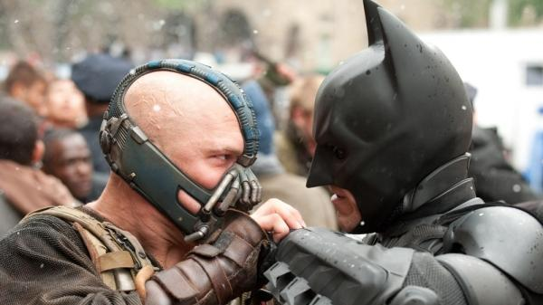 Tom Hardy and Christian Bale in <em>The Dark Knight Rises</em>.