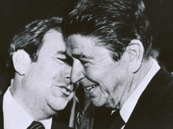Republican presidential hopeful Ronald Reagan, right, listens to the Rev. Jerry Falwell during a campaign stop in Lynchburg, Va., in October 198