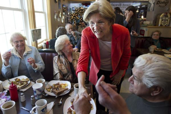 U.S. Senate candidate Elizabeth Warren, a Democrat, greets people at Dinky's Blue Belle Diner in Shrewsbury, Mass., on Sunday.