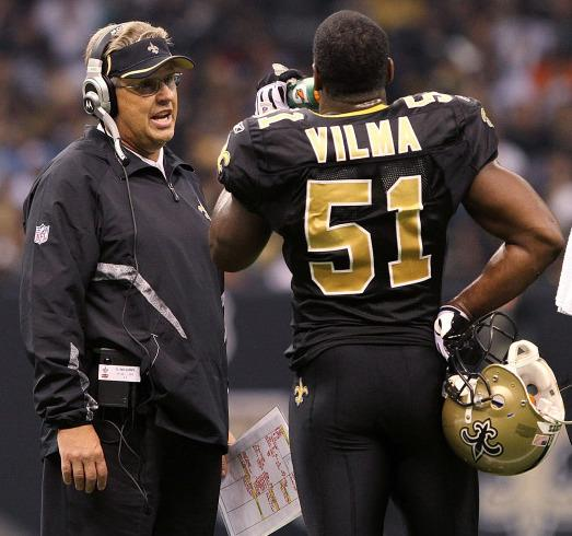 Oct. 31, 2010: Defensive coordinator Gregg Williams (then of the New Orleans Saints) talks to linebacker Jonathan Vilma. Williams has been suspended from the league indefinitely. Vilma will miss the 2012 season.