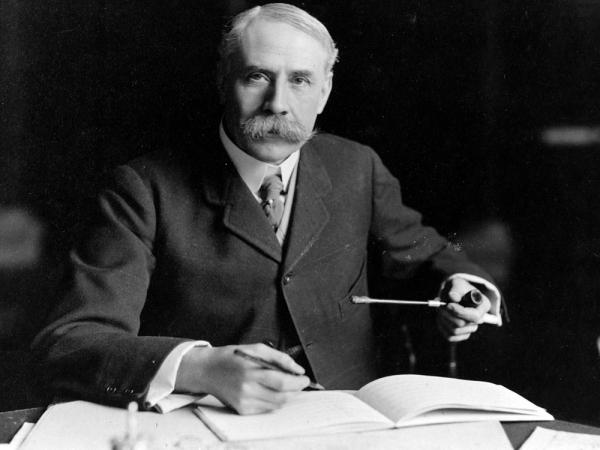 British composer Edward Elgar, seated at his desk at Severn House in Hampstead. His Symphony No. 1 was hailed as the best British symphony ever when it debuted in 1908.