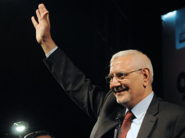 Egyptian former Muslim Brotherhood senior member and now independent presidential candidate Abdel Moneim Abol Fotouh gestures to the crowd on stage during his election campaign rally on April 2, 2012, at the Azhar park in Cairo.