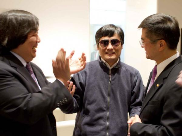 In this photo released by the U.S. Embassy Beijing Press Office, Chinese activist Chen Guangcheng (center) is seen with U.S. Ambassador to China Gary Locke (right) and U.S. State Department Legal Adviser Harold Koh before leaving the U.S. Embassy Wednesday for a hospital in Beijing.
