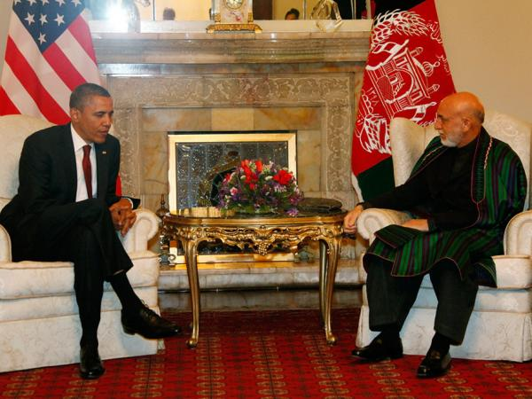 President Barack Obama attends a meeting with Afghanistan President Hamid Karzai, on May 2, 2012 in Kabul, Afghanistan. The U.S. and Afghan Presidents signed a long-term strategic partnership outlining their cooperation following the 2014 withdrawal of NATO and allied forces.
