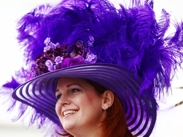 Bridget Voss of Chicago, Illinois wears a Derby hat near the paddock at Churchill Downs on the afternoon of the 2011 Kentucky Derby.