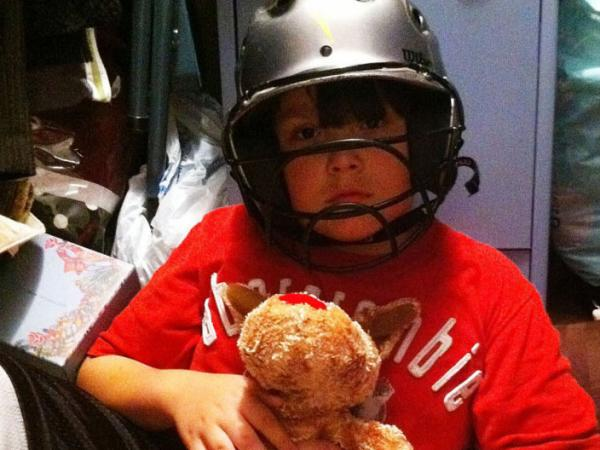 Noah Stewart shelters in the closet just 15 minutes before an April 2011 tornado demolished his house. Wearing the helmet may have saved his life, one doctor says.