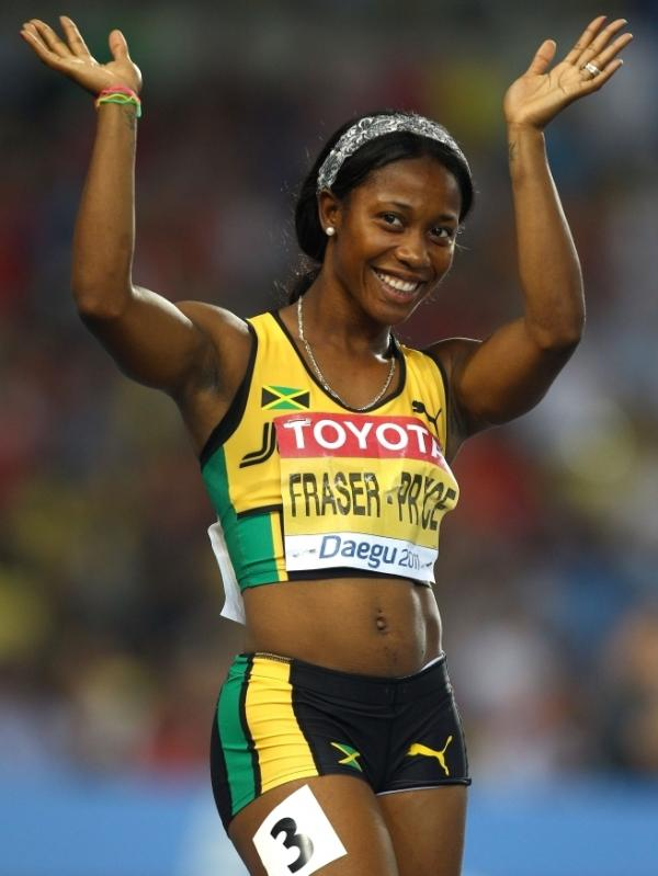 Shelly-Ann Fraser-Pryce waves after competing in the 100-meter semifinal at the World Athletics Championships in South Korea last year. Fraser-Pryce won gold at the 2008 Olympics, and is viewed as a hero by the Jamaican children she sometimes shares a track with.