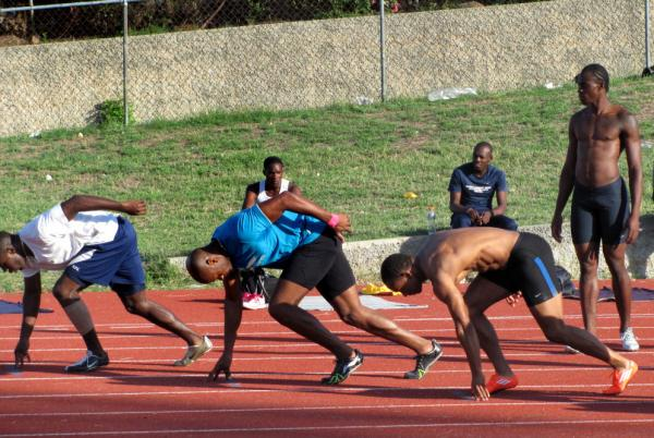 Top Jamaican sprinters, including Olympic gold medalist Asafa Powell (in blue), practice at Kingston's National Stadium on one of the country's few synthetic tracks.