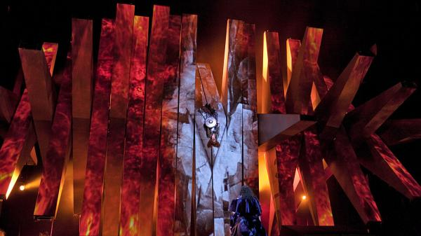 Brünnhilde (center) is surrounded by fire at the end of Wagner's Die Walküre — part of the Met's current <em>Ring</em> cycle, produced by Robert Lepage.