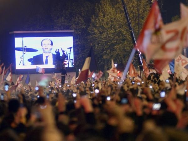 Newly elected President Francois Hollande appears on a giant screen as he gives an adress to supporters of France's Socialist Party in Paris on May 6, 2012. Hollande was elected France's first Socialist president in nearly two decades.