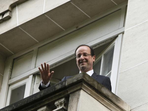 President-elect Francois Hollande waves from a Socialist Party headquarters balcony in Paris Monday May 7, 2012.