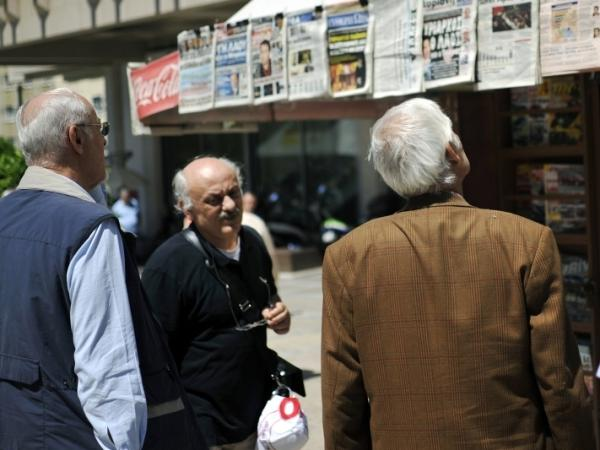 People read headlines in Athens on May 7, 2012. Greece faced an uncertain future Monday after an election shake-up by parties opposed to further vital austerity cuts, sending shockwaves through markets on fears of renewed eurozone turmoil.