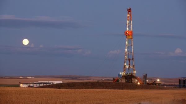 Oil and gas production in the U.S. is rising, and the U.S. is expected to be less dependent on foreign energy in the coming years. This oil drilling rig, shown in October 2011, is outside Watford City, N.D., a state that has seen a boom in energy production.