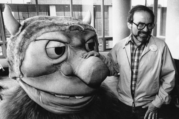 In this Sept. 25, 1985 file photo, author Maurice Sendak poses with one of the characters from his book <em>Where the Wild Things Are,</em> designed for the operatic adaptation of his book in St. Paul, Minn. Sendak died, Tuesday, May 8, 2012 at Danbury Hospital in Danbury, Conn. He was 83.