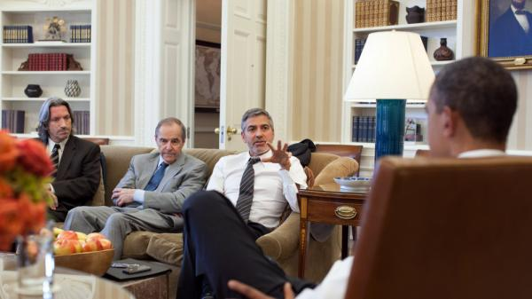 President Obama meets with actor George Clooney, U.S. Special Envoy for Sudan Princeton N. Lyman, and human rights activist John Prendergast (far left) at the White House on March 15.
