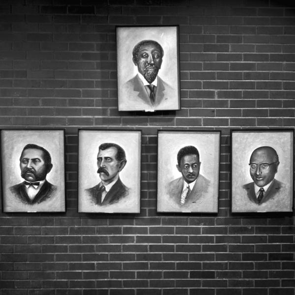 Portraits of the mayors of Mound Bayou, Miss., an early autonomous African-American community, hang inside the Mound Bayou City Hall, in September 2009. The top portrait is Mound Bayou's founder, Isaiah T. Montgomery.