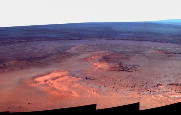 "A mosaic of images taken in January 2012 shows Opportunity's vista north (left) and northeast (right), in an outcrop known as ""Greeley Haven,"" where the rover spent its fifth  Martian winter. The image released by NASA is presented in ""false color,"" to make differences in the landscape easier to see."