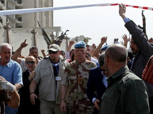 Norwegian Maj. Gen. Robert Mood (center), head of the U.N. observers mission in Syria, arrives to inspect the site of twin blasts.