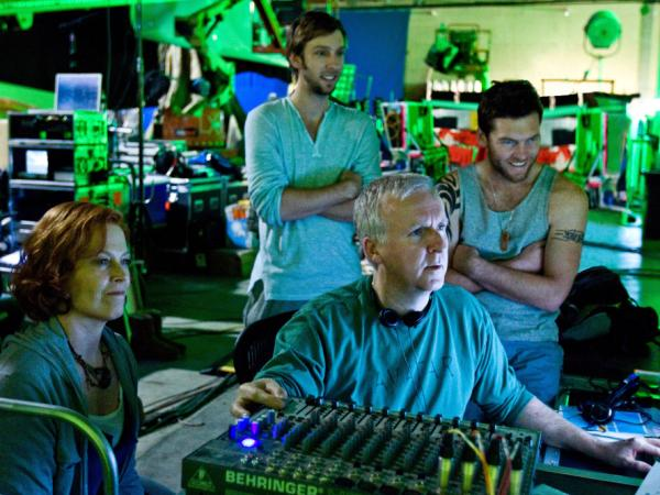 Writer-director James Cameron on the set of 2009's <em>Avatar</em> with cast members Sigourney Weaver, Joel David Moore, and Sam Worthington.