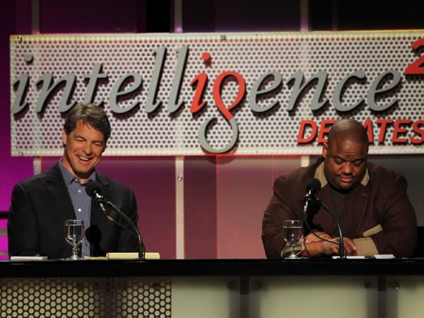 Tim Green (left) and Jason Whitlock argue against banning college football at a May 8 <em>Intelligence Squared</em> debate.