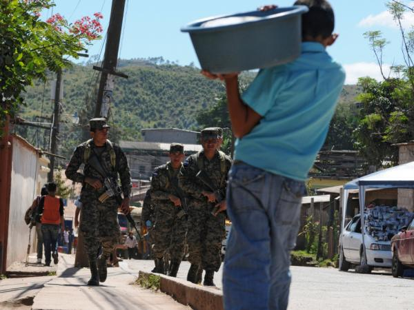 Honduran soldiers patrol poor neighborhoods in the outskirts of Tegucigalpa due to a deterioration of the police force.