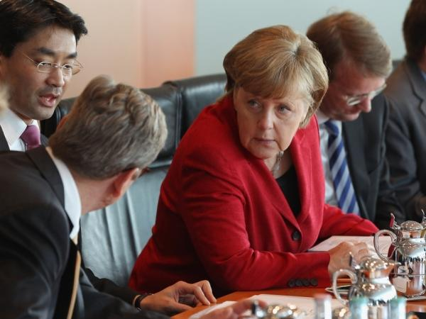 German Chancellor Angela Merkel chats with members of her cabinet during the weekly German government cabinet meeting on May 2, 2012 in Berlin, Germany.